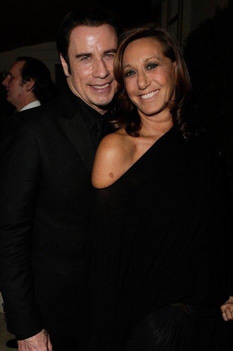 item118.rendition.slideshowWideVertical.07-John-Travolta-Donna-Karan