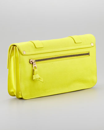 "ZOOM +     Proenza Schouler PS1 Pouchette Clutch Bag, Sunshine  0 Reviews The iconic, studiously designed Proenza Schouler PS1 style in a handheld clutch bag, presented in eye-catching neon yellow. Soft calfskin. Brass hardware. Flap top with metal tab closure and leather strap details. Inside, fabric lining; front open compartment and one zip pocket in back compartment. Exterior back zip pocket. 6""H x 11""W x 2""D; weighs approx. 1 lb. Made in Italy. About Proenza Schouler: Lazaro Hernandez, who worked at Michael Kors, and Jack McCollough, who worked at Marc Jacobs, met at Parsons School of Design. They collaborated on a senior project that became enormously successful, and in 2002 they launched Proenza Schouler (a combination of their mothers' maiden names). The duo was immediately lauded by fashion's highest critics for their design prowess, fresh approach to modern luxury, and technical sophistication. Proenza Schouler PS1 Pouchette Clutch Bag"