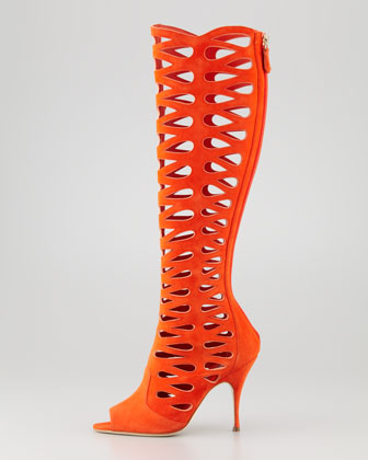 "ZOOM +      Brian Atwood Electra Suede Laser-Cut Open-Toe Boot  0 Reviews Finally—an open-toe, open-minded boot for Spring. Mesmerizing cutouts in a striking orange hue spark a flamboyant flair in this Brian Atwood boot. Suede with allover laser-cut shapely teardrops. 4"" covered heel. Open toe. 16""H; 14"" circumference. Back zip. Soft suede lining; leather sole. ""Electra"" is made in Italy. About Brian Atwood: Old Hollywood glamour meets modern European sophistication in designs from Brian Atwood. After the Chicago native studied art and architecture, his modeling career took him to Europe. In pursuit of moving from the runway to the studio, Atwood was discovered by Gianni Versace and became the first American designer he hired. After time as the head designer of Versace accessories, he introduced his Brian Atwood collection in 2001 to instant critical acclaim and popular success. Every shoe in the line is crafted in Italy with attention to detail. Heel height may vary by size. more Brian Atwood Electra Suede Laser-Cut Open-Toe Boot"