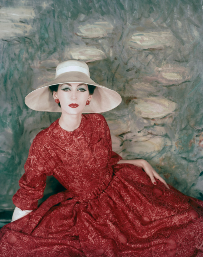 A model wearing a dress and wide brimmed hat by Dior, 1956.