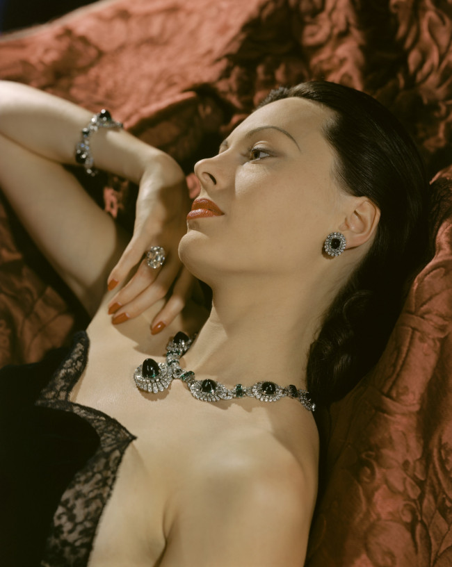 A portrait of Meg Mundy wearing emeralds and diamonds, 1940.