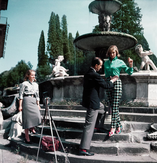 Emilio Pucci prepares a model for a photo shoot in the Boboli Garden in Florence. The model is wearing printed cotton gabardine Capri pants with the Monreale design and a shirt from the Siciliana Collection. © Emilio Pucci Archive, Florence