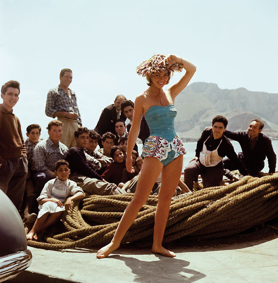 One-piece swimsuit with whalebone bustier and draping culottes in printed and hand-painted cotton, natural straw hat. Model Lilli Cerasoli, from the Spring/Summer Collection. © Emilio Pucci Archive, Florence