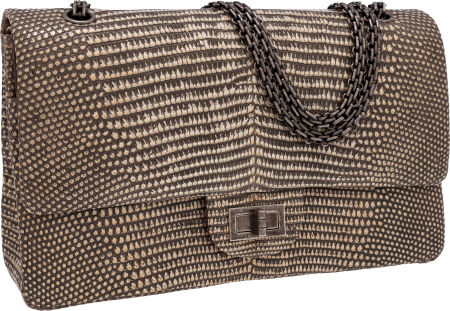 Chanel Natural Lizard Jumbo Double Flap Bag with Gunmetal Hardware The timeless Flap Bag has been a best seller since its introduction by Coco Chanel in February 1955. This incarnation is a true showstopper due to its extra large size and immaculate lizard skin. Jewel chain strap can be worn long or doubled