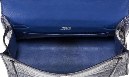 Hermes Shiny Blue Brighton Alligator Kelly Pochette Bag with Palladium Hardware Interior is bleu roi agneau leather with one slip pocket.