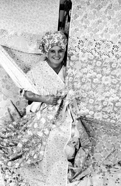 Lilly Pulitzer with fabric. Getty Images, Time & Life Photos, Photographer- Diana Walker