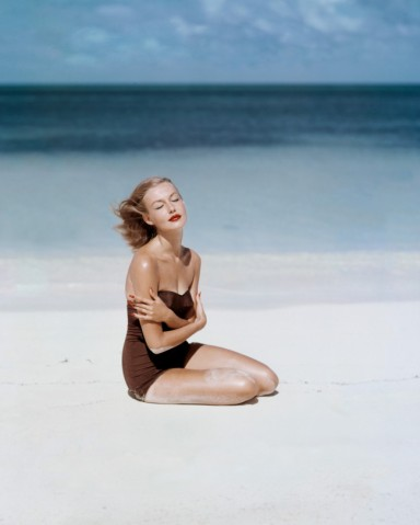 Liz Benn models a strapless swimsuit by Givenchy.