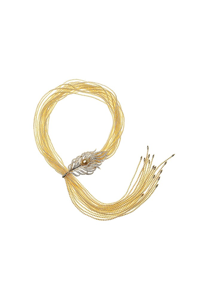 Golden Akoya pearl strands with diamonds faceted with an 18-karat yellow gold and diamond feather clasp and a gold South Sea drop pearl.Photo by John Aquino