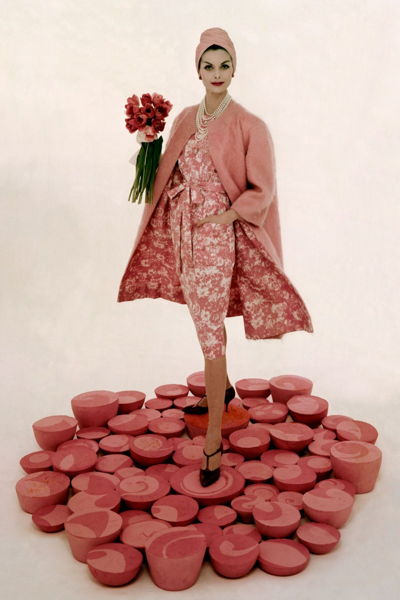 Model wears George Carmel's glorious pink floral print dress and pink mohair coat, photographed by William Bell, 1959.