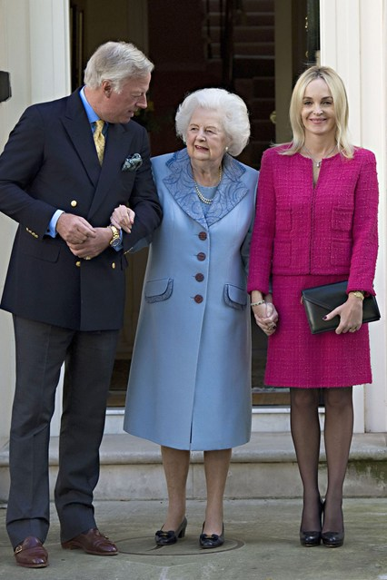 October 13 2012  In a powder blue coat on her 87th birthday with son Mark and his wife Sarah. Photo By Rex Features