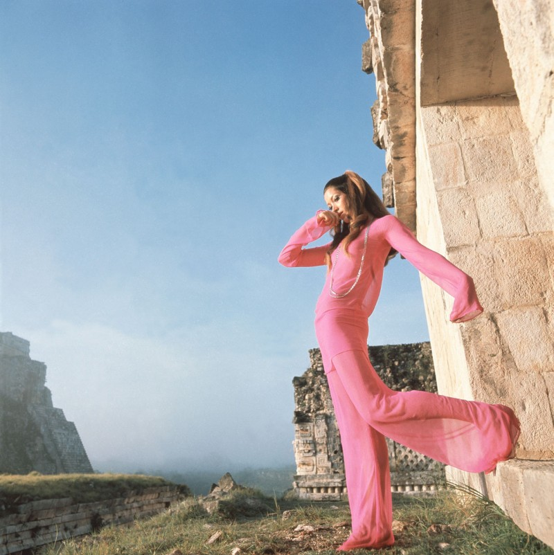 On location at Chichén Itzá, Mexico. A model poses in an evening outfit by Adolfo outside the Temple of Warriors, 1968.