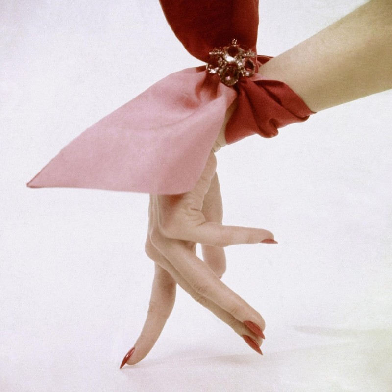 Pink wrist scarf photographed by Clifford Coffin in 1951.