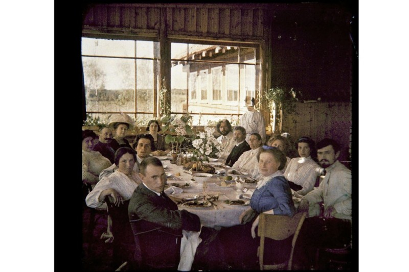 A lunch party in the summer house of dramatist and fiction writer Leonid Andreyev (center back in white suit) in Vammelsuu (Serovo), Gulf of Finland, 1912.Photo by Andreyev Family Album/Leeds University