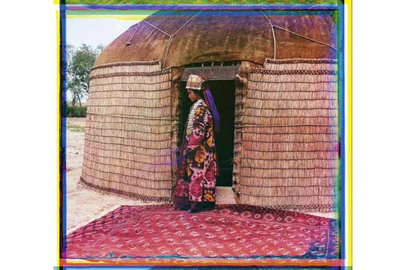 "Young woman in elaborate traditional dress in front of a Kazakh yurt in Central Asia, shot between 1905-1915, from the album ""Views of Central Asia.""Photo by Sergei Prokudin-Gorsky/Library of Congress, Prints & Photographs Division, Washington D.C."