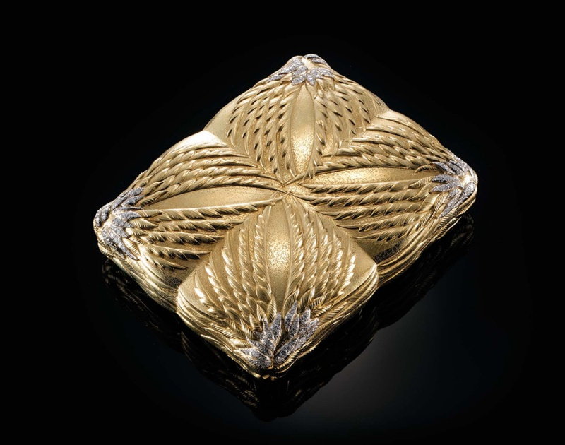 A powder compact by Tiffany, circa 1950, in gold and diamonds.