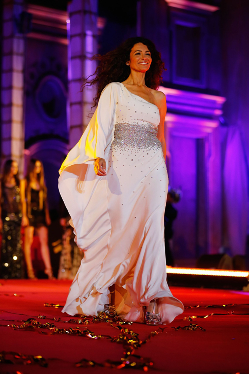 VIENNA, AUSTRIA - MAY 25:  Afef Jnifen walks the catwalk during the 'Life Ball 2013 - Show' at City Hall on May 25, 2013 in Vienna, Austria.  (Photo by Thomas Niedermueller/Life Ball 2013/Getty Images)