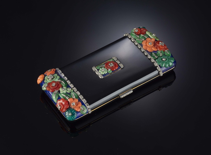An exquisite nécessaire de beauté by Lacloche (French), circa 1920, in black enamel with gold and coral.