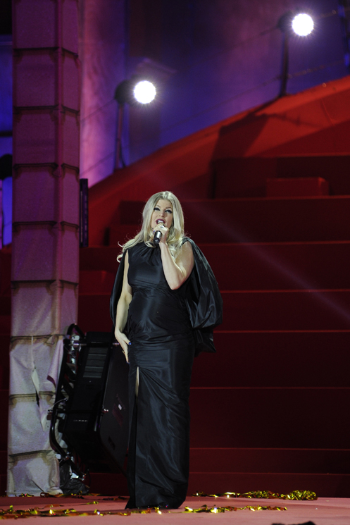 Singer Fergie speaks during the Life Ball in front of the city hall in Vienna on May 25, 2013. The Life Ball is a charity gala to raise money for people living with HIV and AIDS.     AFP PHOTO / SAMUEL KUBANI        (Photo credit should read SAMUEL KUBANI/AFP/Getty Images)