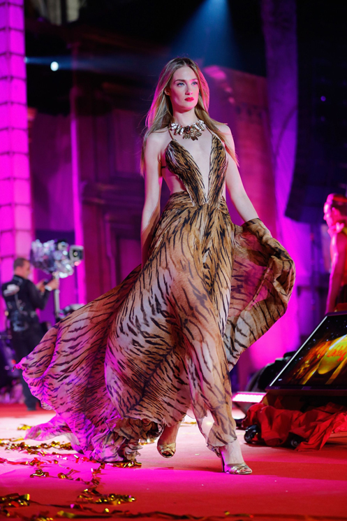 VIENNA, AUSTRIA - MAY 25:  A model walks the catwalk during the 'Life Ball 2013 - Show' at City Hall on May 25, 2013 in Vienna, Austria.  (Photo by Thomas Niedermueller/Life Ball 2013/Getty Images)
