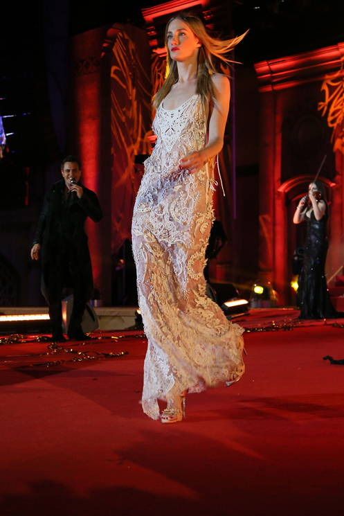 VIENNA, AUSTRIA - MAY 25:  A model walks the catwalk during the fashion show at the 'Life Ball 2013 - Show' at City Hall on May 25, 2013 in Vienna, Austria.  (Photo by Dominik Bindl/Life Ball 2013/Getty Images)