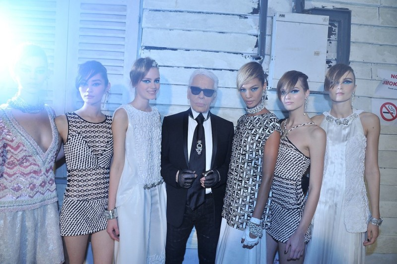 Karl Lagerfeld with models in looks from the Chanel Resort 2014 collection. Photo by Stephane Feugere