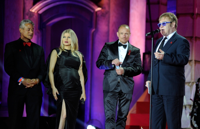 (L to R) US Olympic diving gold medalist Greg Louganis, singer Fergie, Life Ball founder Gery Keszler, musician Elton John attend the Life Ball in front of the city hall in Vienna on May 25, 2013. The Life Ball is a charity gala to raise money for people living with HIV and AIDS.           (Photo credit:v SAMUEL KUBANI/AFP/Getty Images)
