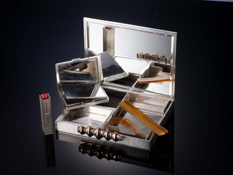 "Inside Van Cleef & Arpels' rectangular ""Nécessaire de beauté"" in silver with silver-gilt, set with rubies, 1930."