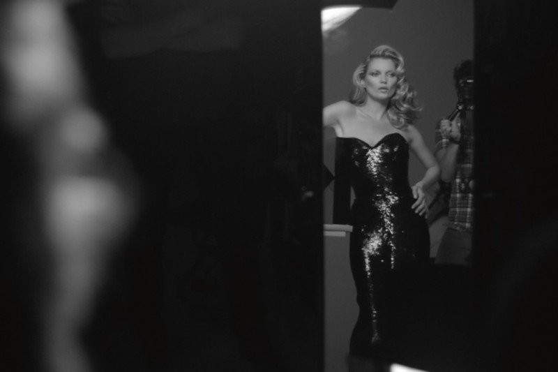 Kate Moss being photographed for the ad campaign. Photo by Solve Sundsbo