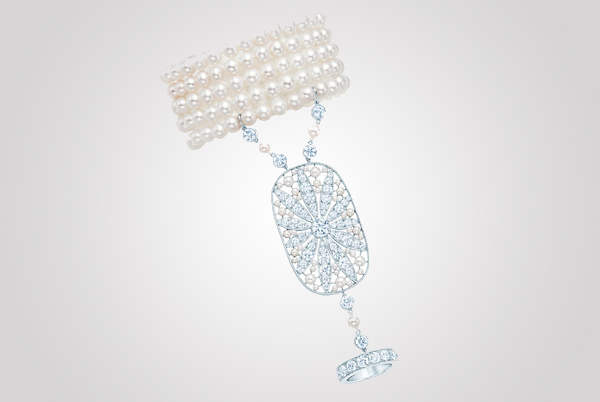 Hand ornament with a daisy motif in diamonds, cultured pearls and platinum. From The Great Gatsby collection inspired by Baz Luhrmann's film in collaboration with Catherine Martin, featured in the 2013 Blue Book. $75,000 Photo Credit: © Tiffany & Co.