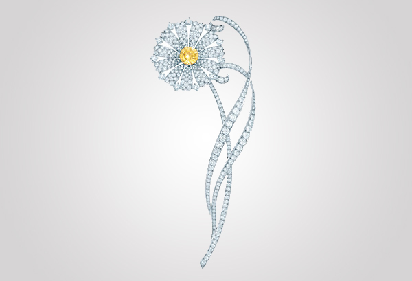 Daisy brooch of white diamonds and a fancy intense Tiffany Yellow Diamond and platinum. From The Great Gatsby collection by Tiffany & Co., inspired by Baz Luhrmann's film in collaboration with Catherine Martin. $50,000 Photo Credit: © Tiffany & Co.