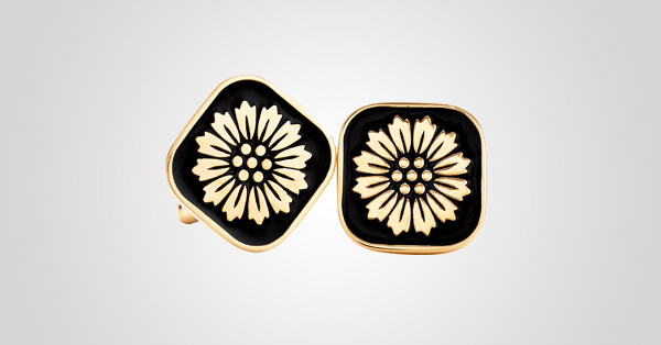 Daisy cuff links of black enamel and 18 karat gold. From The Great Gatsby collection by Tiffany & Co., inspired by Baz Luhrmann's film in collaboration with Catherine Martin. Price upon request. Photo Credit: © Tiffany & Co.