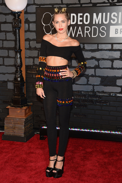 Miley Cyrus in Dolce&Gabbana attends the 2013 MTV Video Music Awards at the Barclays Center on August 25, 2013 in the Brooklyn borough of New York City.  (Photo by Jamie McCarthy/Getty Images for MTV)