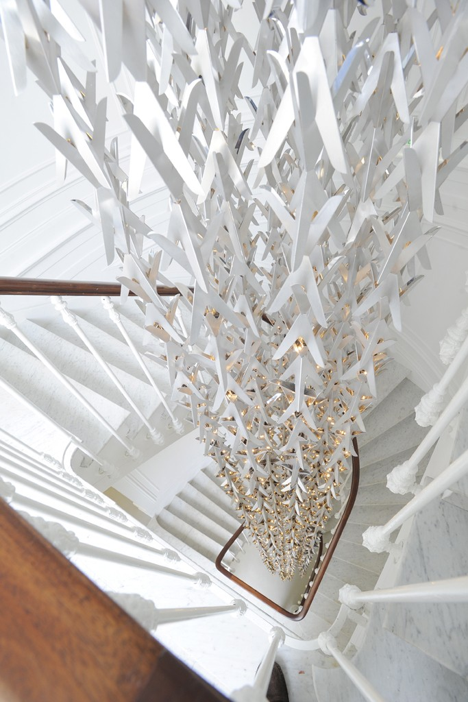A chandelier by Kris Ruhs fills the four-story stairwell. Photo by Dominique Maitre