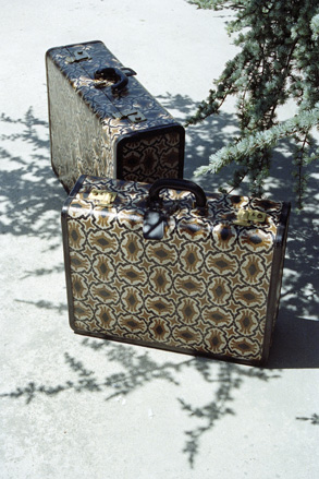 Black calfskin and geometrical print canvas suitcases, 1960