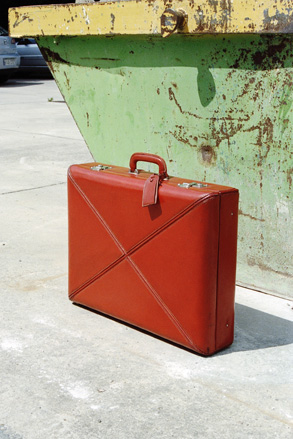 Calf leather suitcase lined with red silk moiré, 1947