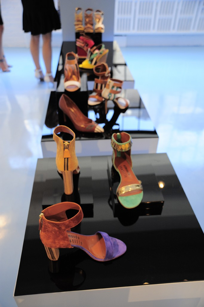 Edmundo Castillo is going low down — for a heel height that is, as seen in this chocolate and purple suede sandal with a chunky 60-mm. heel. Photo by Rodin Banica