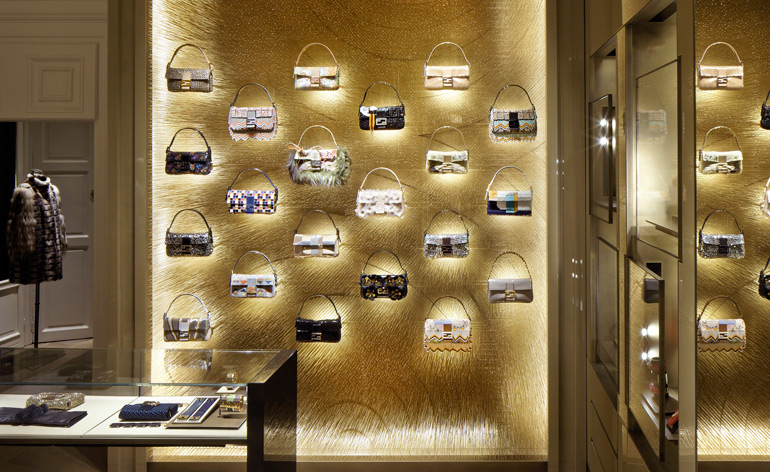 The Baguette collection is presented on a wall composed of 40,000 bronze spikes