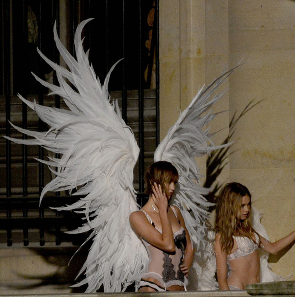 Karlie Kloss, Behati Prinsloo  shooting the Christmas ad campaign for Victoria's Secret at the Louvre in Paris, France