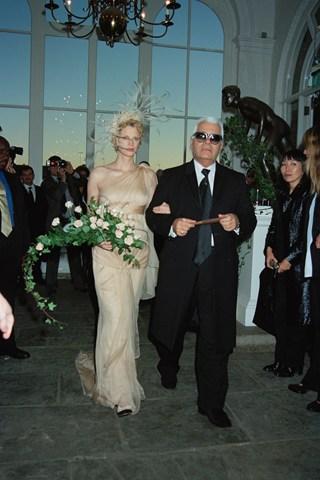 Kristen McMenamy Supermodel Kristen McMenamy married photographer Miles Aldridge in Holland Park's Orangery. Karl Lagerfeld famously walked her down the aisle and designer her dress.