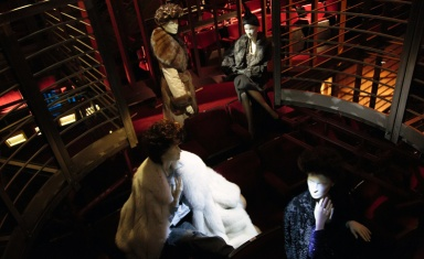 Four mannequins that reproduce Mangano's unmistakeable profile and are dressed in the costumes featured in the film created by Fendi at the time