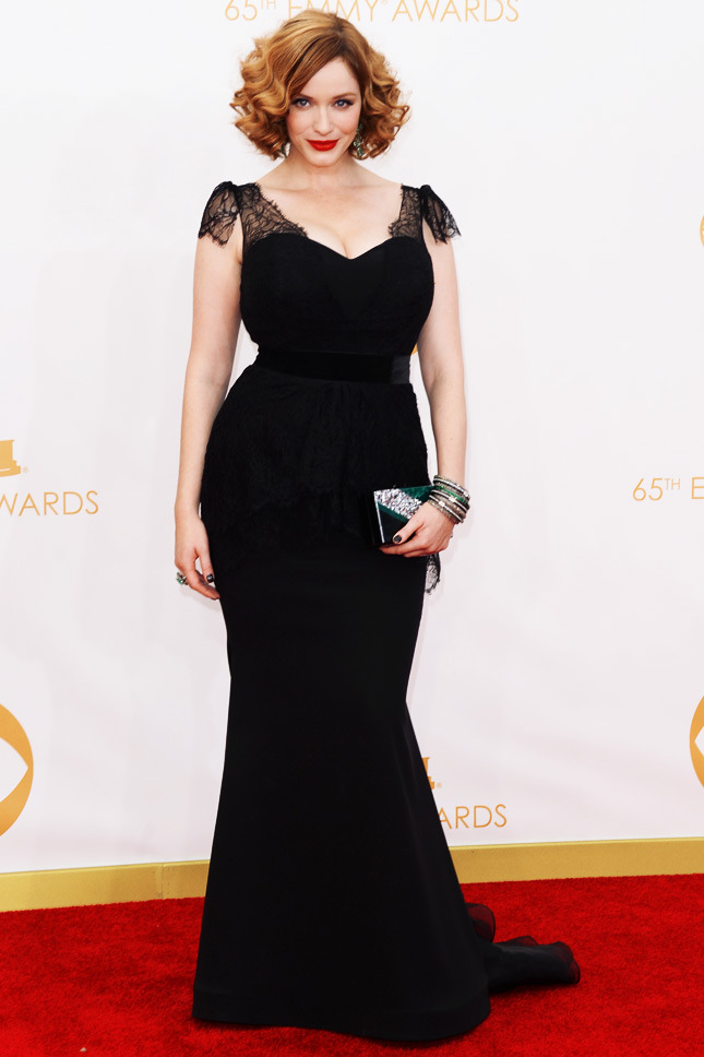 Christina Hendricks, in custom Christian Siriano, with an Edie Parker clutch.