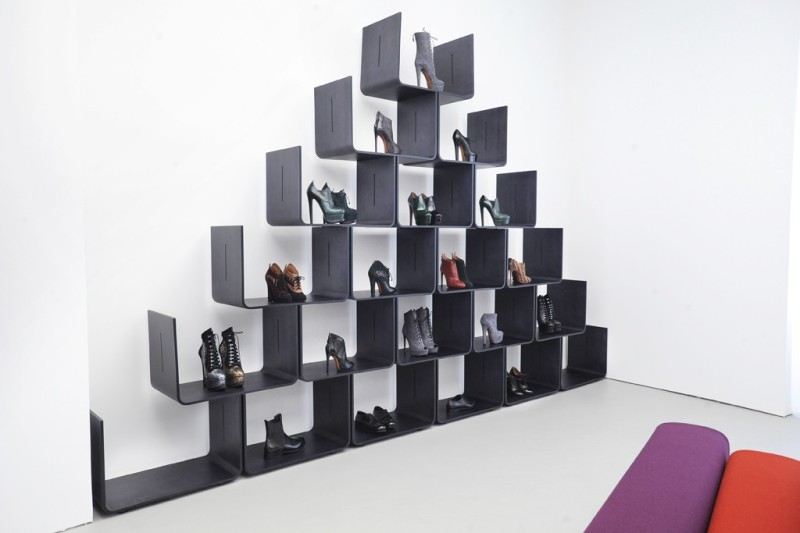 Shoes are displayed in a modular shelf by Pierre Paulin. Photo by Dominique
