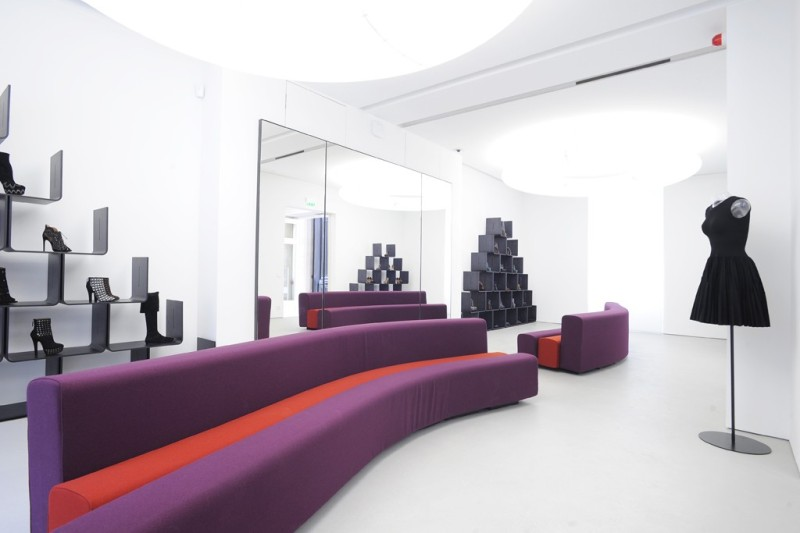The shoe salon features Pierre Paulin shelves and couches. Photo by Dominique Maitre