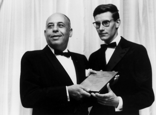 Stanley Marcus presenting Yves Saint Laurent with the Neiman Marcus Fashion Award in 1958.