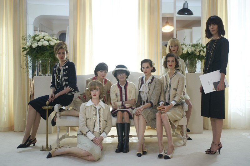 Actress Geraldine Chaplin surrounded by models in Fifties-era Chanel. Photo by Olivier Saillant