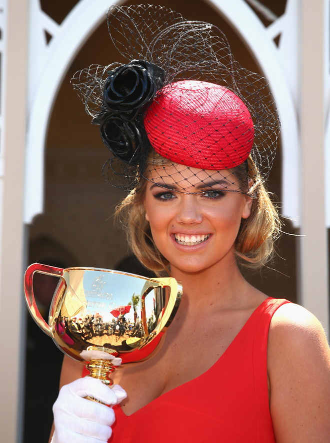 Kate Upton poses with the Melbourne Cup during Melbourne Cup Day at Flemington Racecourse on November 5, 2013 in Melbourne, Australia.  (Photo by Ryan Pierse/Getty Images)