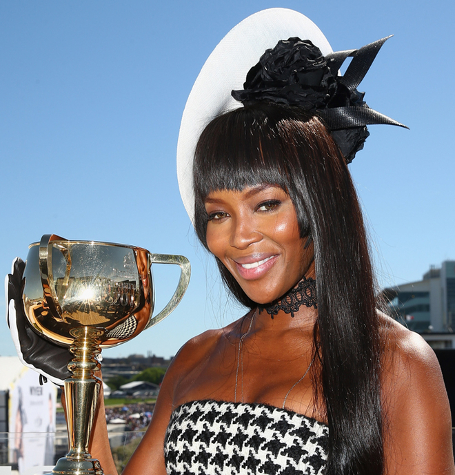Naomi Campbell poses with the Melbourne Cup at the Lexus marquee on Victoria Derby Day at Flemington Racecourse on November 2, 2013 in Melbourne, Australia. (Photo by Cameron Spencer/Getty Images for the VRC)