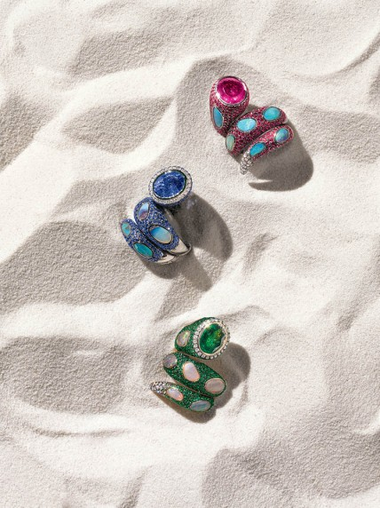 Wendy Yue  18k blackened gold triple-wrap rings. Hong Kong. Tsavorite, white diamond and opal $13,600. Rhodolite garnet, ruby, pink sapphire, white diamond and opal $15,200. Tanzanite, white diamond, blue sapphire and opal $18,250.