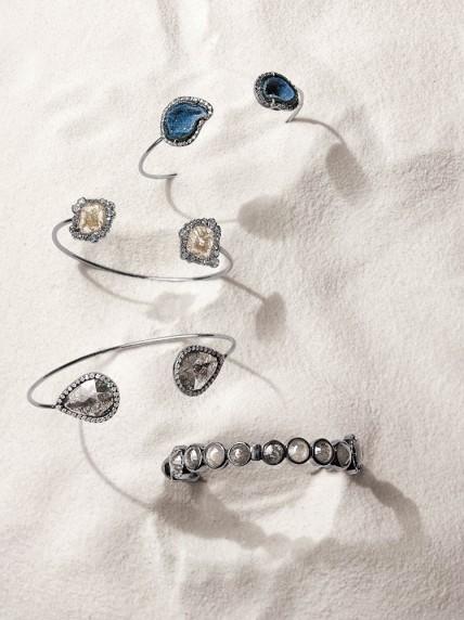 Kimberly McDonald Geode and diamond cuff. $4,850. Black diamond slice cuff. $23,950. Bezel-set rough diamond hinged bangle. $50,425.