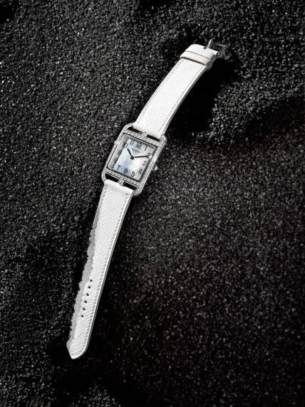 "Hermès ""Cape Cod"" stainless steel and diamond watch with white calfskin strap. Quartz. Switzerland. $14,850."